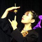 performance photo with a bell